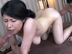 This hot brunette Japanese expresses her lusty desires, in the company of two horny guys, that enjoy the sight of her naked body and lovely boobs. Watch her hairy cunt getting fingered, while she is crawling on the floor, to suck cock