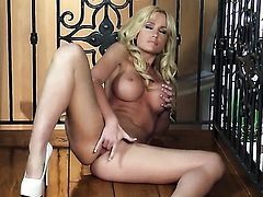 Angela Sommers with giant hooters and clean twat polishing the pearl