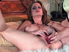 Busty Emily Addison bangs a toy into her pussy