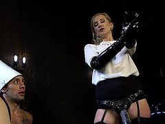 Beautiful Madeline Marlowe has no rival, when it comes to punishing submissive men, without any second thoughts. She is the most blonde fierce mistress, earning this title by frequent use of whip on naughty boys. She looks very hot, wearing that kinky strap on. See her using it on her slaves!