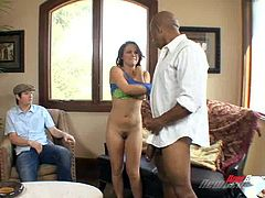 A MILF cuckolds her husband with a hung black stud