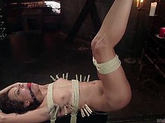 If you're addicted to bdsm kinky activities, see a busty mistress using her sex slave. Don't miss the inciting rim job. As the brunette is obliged to wear a ball gag and gets awfully bonded with rope, the atmosphere grows hotter!
