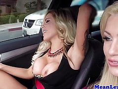 Busty lesbian dominated by her blonde driver