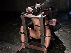 The slutty ebony bitch trapped in the merciless executor's dark basement, cannot help herself, wondering what kinky game he's up to now! Click to watch the naked slut with small lovely tits and tattooes bonded strongly. Don't miss the inciting details.