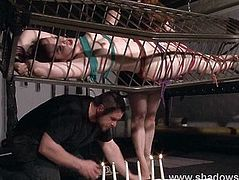 Caged american fetish model Caroline Pierce in hot wax bdsm and deprived lesbian kink