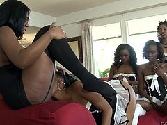 There are four ebony ladies waiting patiently their turn, to savor their mistress' tasty cunt. Click to watch the dominant brunette slut with big tits, face sitting and getting extremely aroused. Enjoy the sexy details!