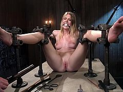 Slutty Ashley has become a completely helpless prisoner of a hard metal bondage device. The naked blonde-haired bitch with small tits is also wearing a kinky ball gag, while a merciless executor tortures her... See how this naughty victim deals with the painful pleasure. Enjoy!