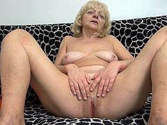 Evan is definitely a wild one for the granny section of porn. She handles her own business, using more than just her hands and standard sex toys. She works herself with her fingers, moving on to a dildo. That is not enough for her, though, as she takes a small traffic cone and inserts it! Watch now!