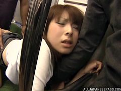 A crazy Japanese gets awfully used in the public transport. She doesn't seem to be annoyed by the pushing horny guys, as she doesn't oppose them. On the contrary, she spreads legs widely and exposes her hairy cunt... See this bitch pounded hard from behind!