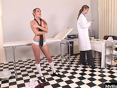 Angel Pink and Anita Pearl are nurse and patient and when the tall nurse tells her blonde patient, to takes off her bra, allowing her to check out her small, puffy nipples hooters, she has her bend over and begins spanking her buttocks until it reddens. Next, she takes her temperature by inserting a sex toy into her shaved pussy, until she reaches an orgasm.