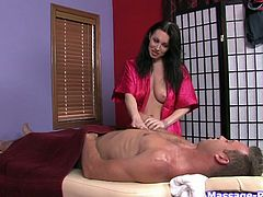 Pretty naughty long haired brunette masseuse gives dude a strip show