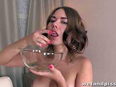 Watch Diana Dali getting wet and dirty all over in her own urine