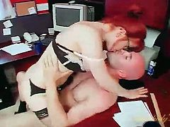 Naughty redheaded secretary in lingerie blows her boss
