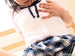 The sexy young lady, wearing a school uniform, seems very innocent. In fact, she is about to explore her femininity and get acquainted to using kinky sex toys. Click to watch the slutty brunette Asian with sensual glossy lips, lifting up her skirt.