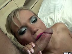 Randy blonde in stockings wraps her lips around a dude's cock