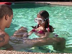This cute teen is with her boyfriend in the swimming area. She puts on mask for diving, to suck his cock underwater. It looks like she has been caught by the milf, so now the sexy older woman is going to show this teen the proper way to suck cock.