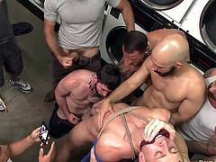 A naked guy has to confront a gang of horny men in a public laundry. Click to see his cock blown with fervor, while he is awfully bonded with ropes and gagged. Watch the stud's appetizing ass fingered deeply!
