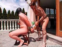 Masked stud submits to his kinky dominatrix outdoors