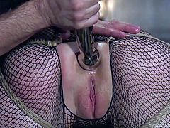 A horny dominant guy stuffs a big anal dildo in Mandy's crazy ass, while using a kinky vibrator, to arouse her cunt in the same time. The brunette bitch is wearing sexy fishnet stockings, which is a huge turn on... Watch this naughty naked lady, mouth fucked and banged!