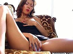 Sweet Japanese cutie on the couch masturbating with her fingers