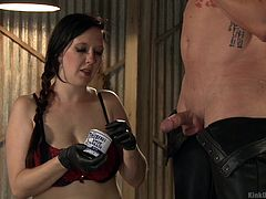 Mike helps Nerine to perform a demonstration. Usually, pain to the balls is something that guys try to avoid. In this lesson, she demonstrates how to grease up his cock and lightly ties a shoestring around his nuts. He controls the pressure and she works him with her hands. Take notes!