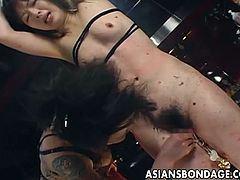 Asian slut has a hairy cunt and she gets it fucked by her man as she is on the floor. Sex is so raw and awesome. She moans and screams like a true street player.