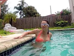 Naughty Kymberlee swims in the water, while being blindfolded. These uninhibited college girls are eager to play dirty and have fun with their horny partners. See the slutty blonde exposing her lovely boobs to the camera, and sucking dick. Enjoy the sexy scenes!