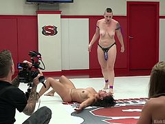 In this lesson from Kink University, we see a couple of women backstage, talking to a guy about the demonstration they're about to do. If you've ever seen kinky wrestling, this is learning about how to do it. This way, you can have fun, be safe and get the most out of your fetishes with your partner.