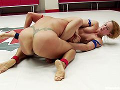 It's a very tight round, as the two ladies in the wrestling arena are both very quick and take each other by surprise with their spontaneous movements. Click to watch the hot brunette and the naughty blonde bitch, struggling to win this fight!