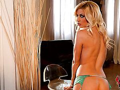 Blonde Jessie Volt has fire in her eyes as she plays with herself