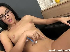 Nerdy dark haired sweetie shows her hot cunt and starts to drill it with joy