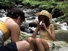 This cute couple have come to a famous waterfall, just outside of Nagoya, to have a naughty time with each other. The hot partners get nude. The sexy slut shows off her perky nipples and amazing boobs. She loves it when her man's hand is down her panties and his hand is on her boobs.