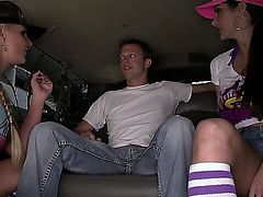 Ava Addams and Phoenix Marie try out the hard rod of the lucky dude in the car. They both are so eager to get it inside their mouth and spit on the throbbing dick-head.