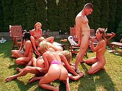 A backyard orgy where everyone fucks everyone all over the place