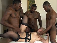 Nice ass blonde has her holes plugged with big black cocks in an interracial gang bang