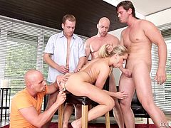 lusty blonde entertains a gang of guys @ 4 on 1 gang bangs