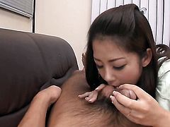 Busty Asian Satomi gives a blow