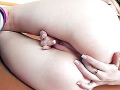 Avril Hall with small breasts and clean pussy fingers her wet hole