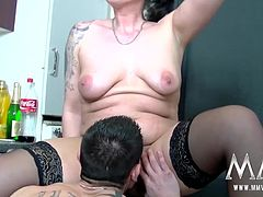 Mature brunette pulls down her undies and takes a hard cock before getting her tits covered in jizz.