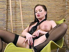Silvia Saint does striptease before she sticks her fingers in her pussy