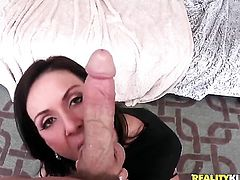 Brunette stunner Kendra Lust with huge hooters and bald snatch lets Johnny Sins put his snake in her mouth