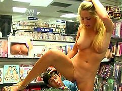 Brynn Tyler is a big ass porn star that has huge tits. She is at a sex toy shop and she is trying on some things. The store owner helps her out.