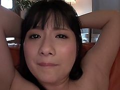 An Koshi is an Asian milf that is having her pink pussy handled with vibrators. The men are caressing her with them until she reaches an orgasm.
