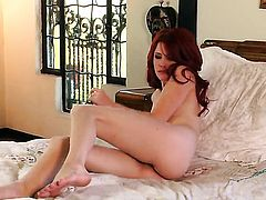 Elle Alexandra with tiny tities and shaved pussy is completely naked and plays with her love tunnel non-stop