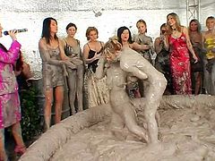 Catfight party where two hotties get messy in the mud pit