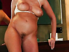 With big hooters and trimmed cunt strips down to her bare skin to play with her love hole naked