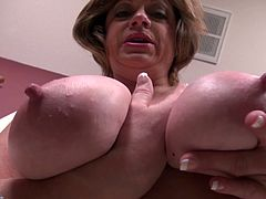 Piper is the ideal woman for those, that like their lovers older with a high sex drive. Piper shows off her assets, and what assets they are! Her tits are so huge you'd strain your arms lifting them. She does just that with ease, sucking her own nipples and squeezing her massive mammaries. Watch her play!