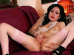 Aiden Ashley has fire in her eyes as she fucks herself with sex toy