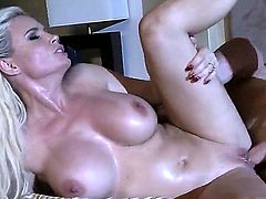 Huge tits blonde is in the bedroom