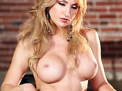 Tattoos Angela Sommers with massive boobs and hairless snatch does striptease before she sticks toys in her love box